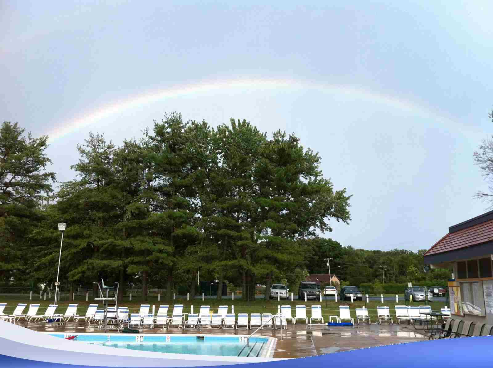 A rainbow over our pool. It's a sign that you should join.